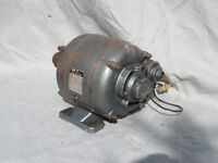 1/4 h.p. Electric motor, and pulley. Ideal for lathe, bandsaw, or other machinery. Single Phase.
