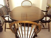 Real Wood Dining Table with 4 Carvers and Cabinet.