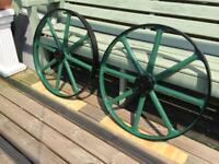 Cast iron carriage wheels .