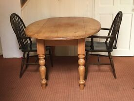 Free solid wood table and two chairs need a re paint