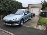 Peugeot 206 with tow hitch & 1/2 ton trailer
