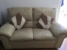 2 x cream leather sofas (both 2 seaters)