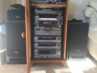 Hifi system with 5 cd changer, record and tape players. Includes 4 speakers for surround sound