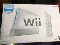 Nintendo Wii + Wii Fit Board, games etc