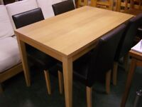 Dining Table and 4 Chairs in Light Wood . Dining Set. Good Condition