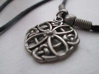 Flower shaped metal pendant