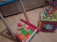 Wooden bricjs and push along trolley and wooden puzzle