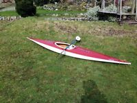 Bright sparkly red 13' single person classic canoe barely used in excellent condition with paddle