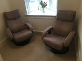 Suede swivel nearly new recliner chairs
