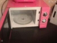 Pink microwave and toaster