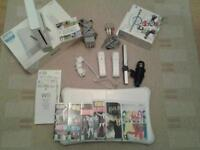 Wii gaming console,fit board,mariokart bundle plus games and controllers