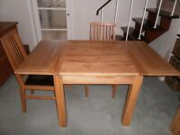 Dining table and four chairs in solid natural oak