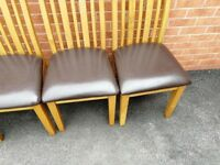 Solid oak dining table and 6 leather chairs. Very sturdy and extremely good quality.