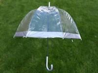 A 60's inspired retro silver/clear umbrella