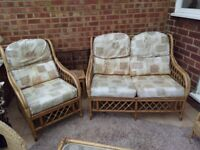 Two seater sofa, 2 chairs and glass topped conservatory furniture