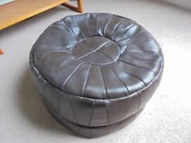 A Brown Leather Puffy.#1