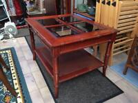 Solid flame mahogany coffee/side/occasional table with glass panels excellent good condition