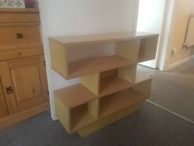 Shelving unit made up of various cubes and shelves - beech coloured s