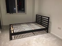 Ikea Tarva Double bedframe (black) with Leirsund bed base