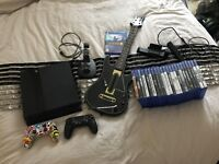 Sony Playstation 4 with 23 Games and 2 Controllers + Extras