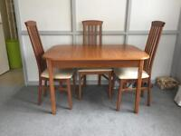 Table and 4 chairs 72H 118W /157W 80 D