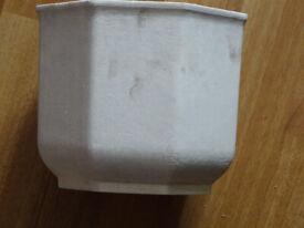 white plastic plant pot