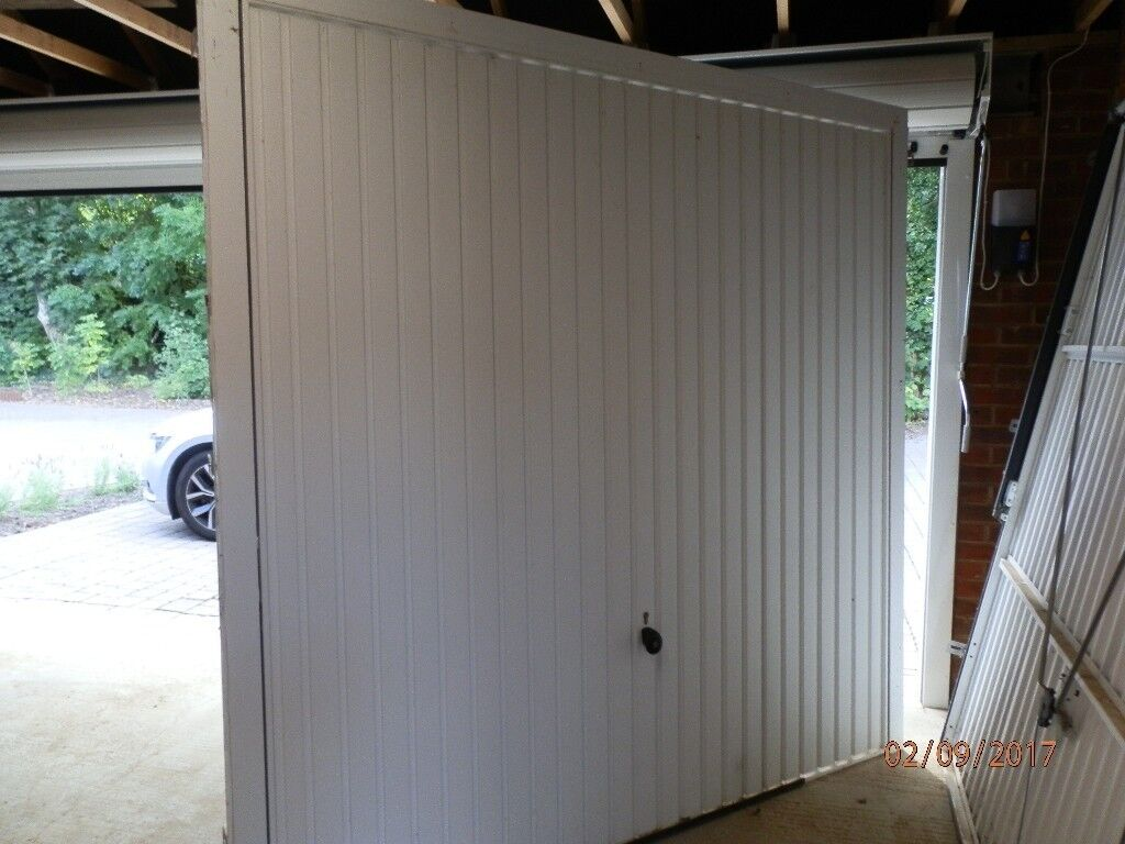Two hormann white metal up and over manual garage doors each with image 1 of 3 rubansaba
