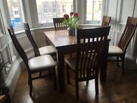 Extendable wooden dining table and six chairs
