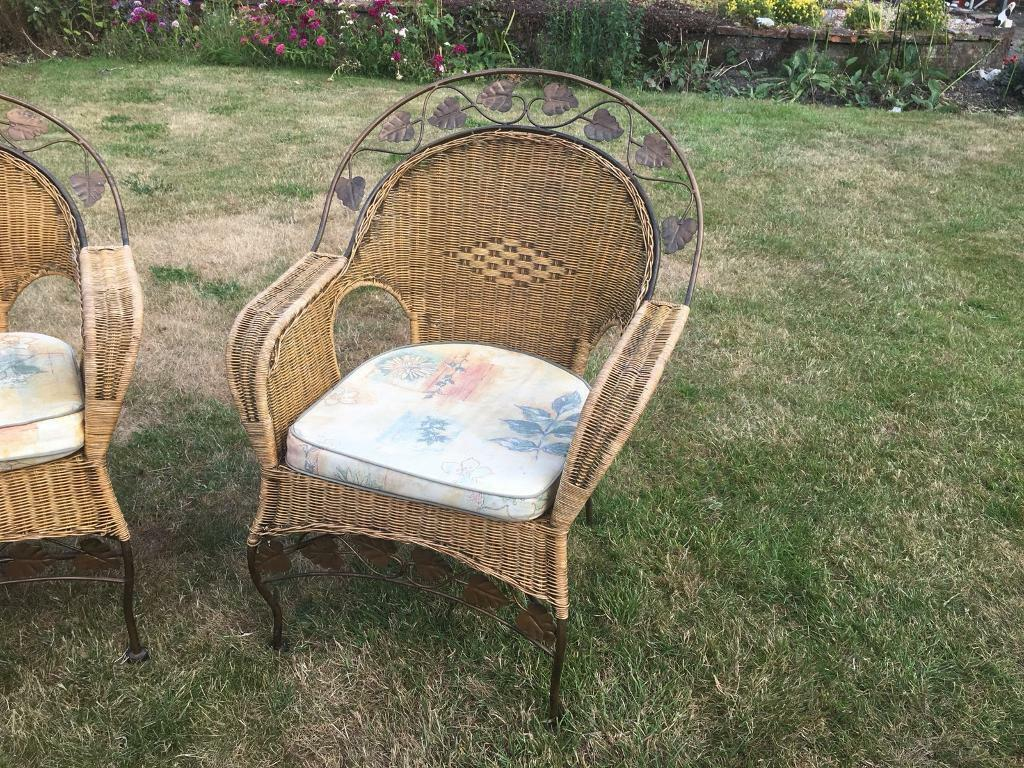 Conservatory furniturein Norwich, Norfolk - Two seater and two one seater wicker seats with cushions. One metal leaf missing as shown in pic (was like that from new!) reasonable condition