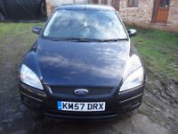 FORD FOCUS STYLE 1.4 PETROL IN BLACK WITH 1 YEARS MOT ..PRICE REDUCED AGAIN !!!...TO SELL...