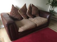 Brown leather two seater sofa with scatter cushions