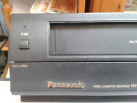 VHS Top Brand Video Recorder and box full of VHS tapes