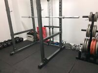 DUMBBELLS, POWER SQUAT RACK, OLYMPIC BAR AND WEIGHTS AND BENCH
