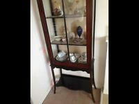 Edwardian glass cabinet.