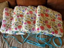 FOUR PRETTY CHAIR CUSHIONS