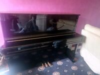 Black upright Astor piano
