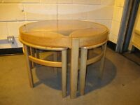 VINTAGE NATHAN TEAK ROUND GLASS TOP COFFEE TABLE WITH THREE SIDE TABLES INSET FREE DELIVERY