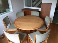 Dining room table, chairs, side board.