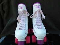 Adult Roller Skates. Size 6. In excellent condition. White with pink and purple.