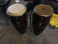 Set of two vintage full size congas with stand.