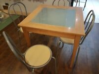 Glass topped table and four chairs
