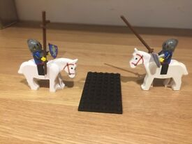 Lego figures soldiers on horses