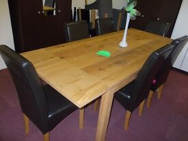 New linford solid wood extending dining table + 6 black skirted chairs