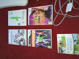 Nintendo wii and wii fit board.