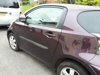 Plum coloured toyota iq . Excellent economical runaround.. £30 to fill tank up with petrol.