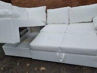 Very nice BRAND NEW white faux leather corner sofa bed with storage.delivery available