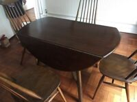 Ercol drop leaf dining table with 4. Chairs