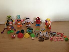 Five Large And 1 Small Potato Heads with many accessories Very Good Condition