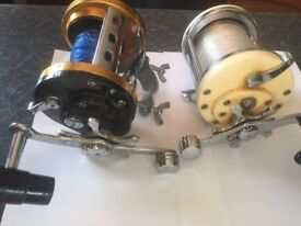 two fishing reels (penn mag power 980 ) and boat reel mitchell 600