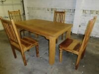 Solid wood cottage table and four chair set. Beautiful multicoloured woods. Excellent condition £199